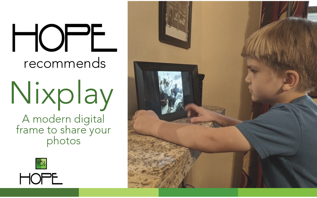 Young boy looking at digital frame
