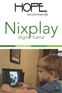 Young boy looking at a digital frame