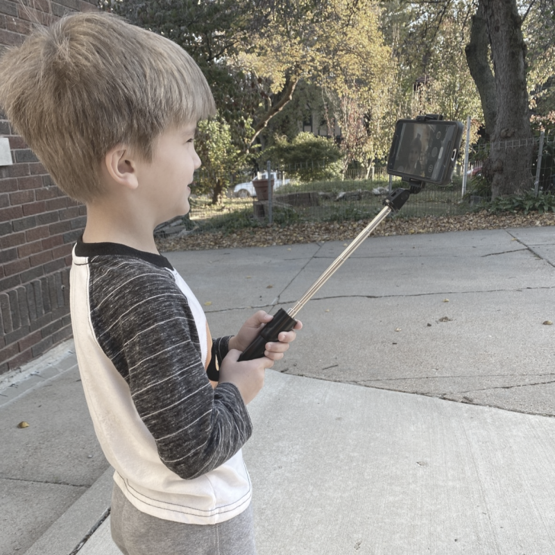 Young boy with selfie stick